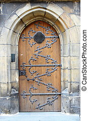 Medieval front door in the downtown of Prague, Czech...
