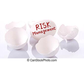 Risk management Egg and broken eggshells on white background...