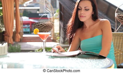 woman relaxing in Cafe