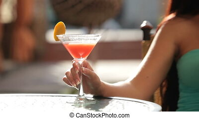 female hand with  martini  glass