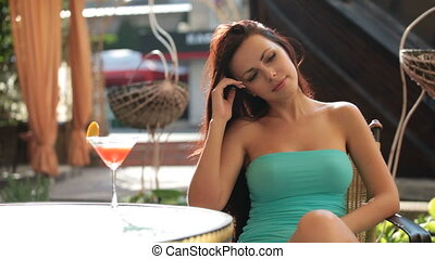 beautiful woman enjoying a cocktail