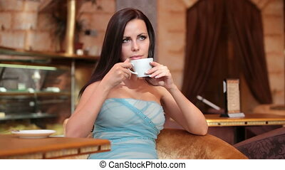 young woman in a coffee shop