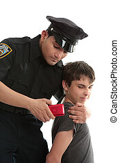 Police officer with teen uvenile delinquent - A policeman...