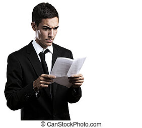young man - portrait of handsome young man reading a...