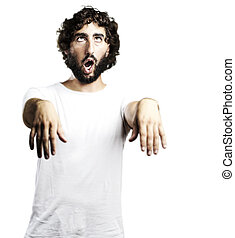 young man imitating a zombie against a white background