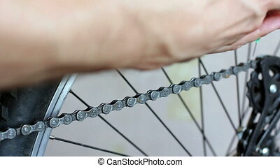 bicycle - Greasing the chain on a bicycle