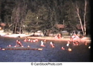 Swimming At The Lake 1973 Vintage - A young family spends...