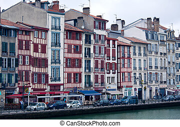 Old buildings along bank of Nive, Bayonne, France