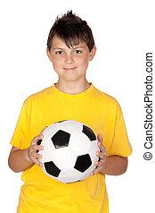Adorable boy with a soccer ball