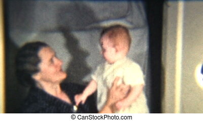 Baby Girl With Grandmother (1939) - A cute red headed baby...