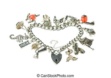 old charm bracelet heart - an old isolated charm bracelet in...