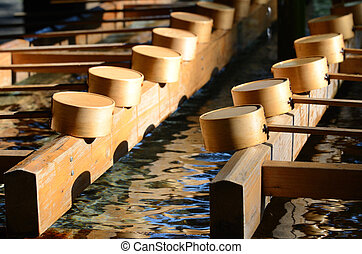 Tsukubai is a small basin provided in Japanese Buddhist...