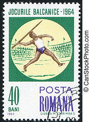 Javelin throw - ROMANIA - CIRCA 1964: stamp printed by...