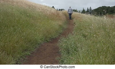 older man on hiking trail