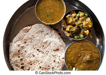 Traditional Indian cuisine vegetarian thali served in small...