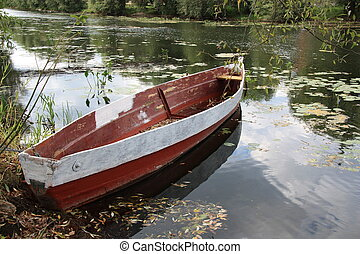 Fishing boat at river in Russia - Old wooden boat at river...