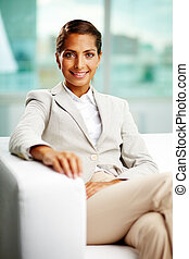 Female entrepreneur - Portrait of successful female sitting...