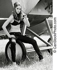 female portrait. retro style aircraft pilot