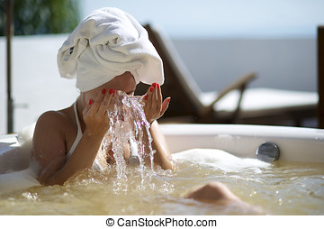 Woman relaxing in a hydromassage bath in Brazil - Woman...