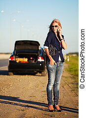Woman calling for help - Young blonde with a broken car...