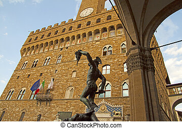 Perseo and Palazzo Vecchio - View of bronze statue of Perseo...