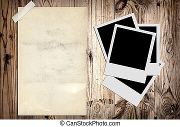 Blank photo and old poster on wooden background