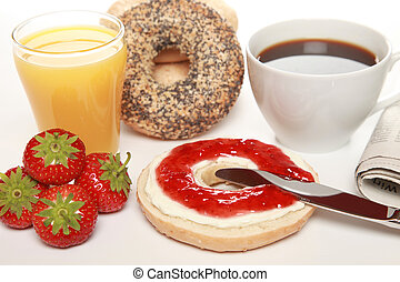 Breakfast with fresh bagels served with cream cheese,...