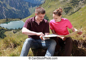 Male and female hikers in the Alps