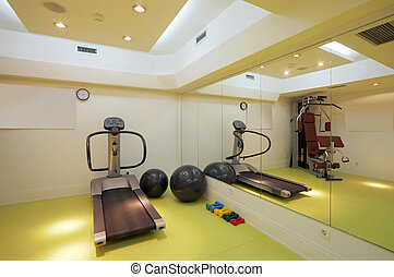 Fitness - Interior of an empty fitness club with equipment