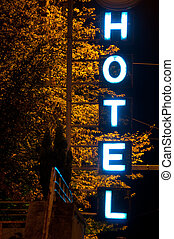 Hotel Neon Sign - blue hotel neon sign outside of German...