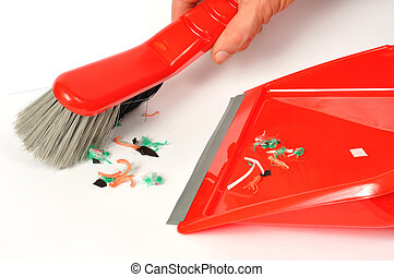 Brush and Dustpan - Red brush and dustpan with some garbage...