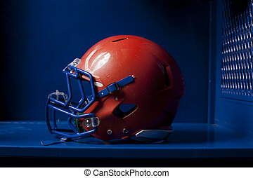 Football Helmet in Locker - An american football helmet sits...
