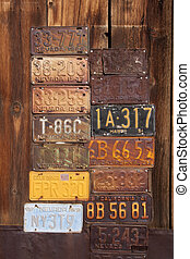 Vintage License Plates with a wood background