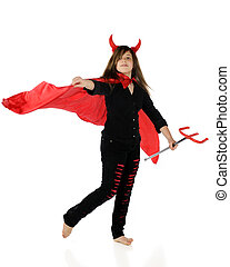 Preteen She-Devil - A pretty preteen girl in a devil outfit,...