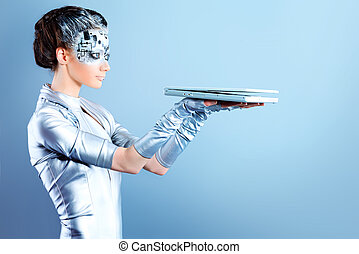high technology - Shot of a futuristic young woman with a...