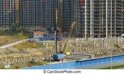 Piling - Builders hammer in piles on the building site