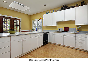 Kitchen with skylight - Kitchen in home with skylight near...