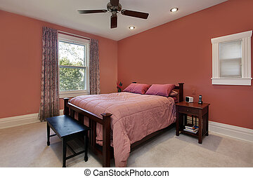 Master bedroom with peach colored walls