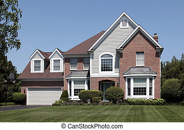 Brick home with arched entry - Brick home in suburbs with...