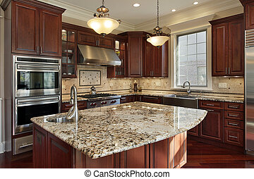 Kitchen with granite island and cherry wood cabinetry