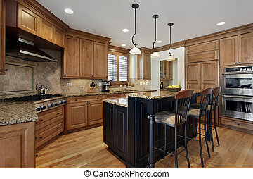 Luxury kitchen with granite island and wood cabinetry