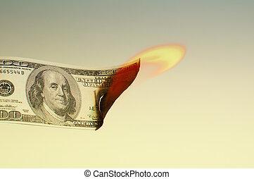 Dollar burning - Hundred dollar bill is burning, close up...