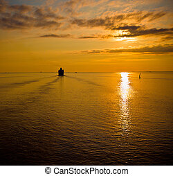 cruise liner in the sea at sunset