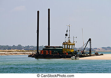 sand dragger boat - View of a sand dragger boat anchored on...