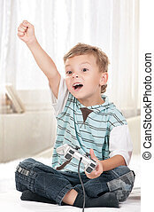 Happy child playing a video game - Happy child - little boy...