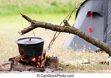 Pot on fire - Camping kitchenware - pot on the fire at an...