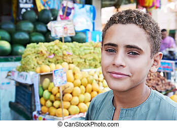 arab youth invites to purchase fruits - HURGHADA, EGYPT -...