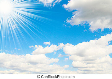 Sunbeams high on the blue sky. - Blue sky is covered by...