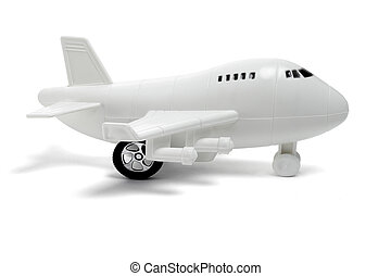 Plastic toy passenger jet plane on white background