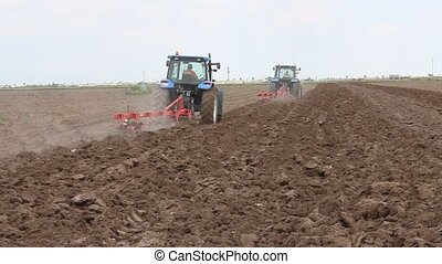 agriculture - Agricultural land and tractor image